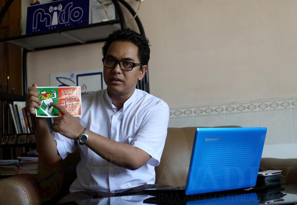 Nay Phone Latt, online activist and director of MIDO, shows material from his new anti-hate speech campaign, which began last week. (Photo: Hein Htet / The Irrawaddy)