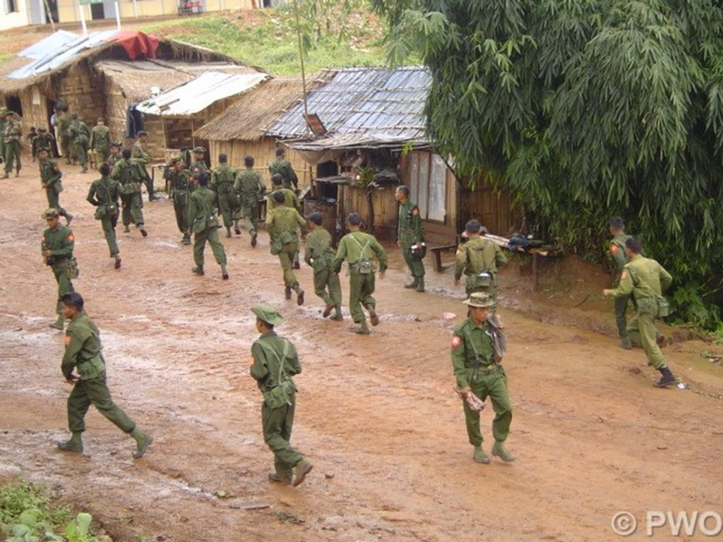Burmese soldiers entering Palaung village