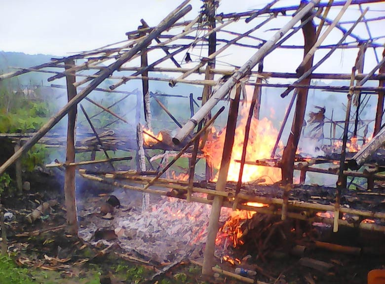 Villager's house set ablaze by the Burma police force and officials from the Burma Department of Forest Management in B--- village, Hpa-an Township, in June 2015 District. (Photo: KHRG)
