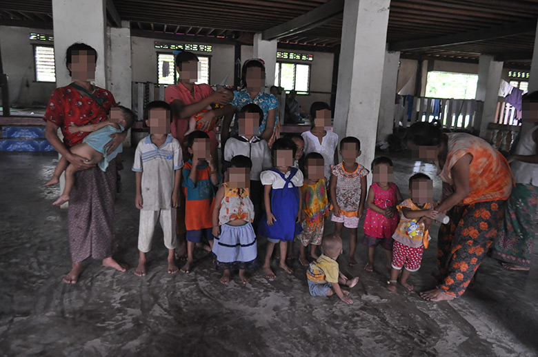 This photo was taken in Myawaddy, Kawkareik Township, in Dooplaya District on July 8th 2015. It shows some of the villagers who fled to Myawaddy after the Burma government officials and police came and burnt down their houses on June 22nd 2015. [Photo: KHRG]