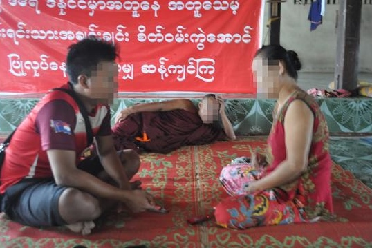 This photo was taken on July 8th 2015 in Myawaddy. It shows Ma A--- being interviewed by the KHRG after fleeing to Myawaddy following the incident in which Burma government officials and police burnt down her house and attempted to arrest her. (Photo: KHRG)