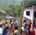 Halockhani villagers facing their new hospital with the old collapsing hospital behind them. (Photo: Burma Link)